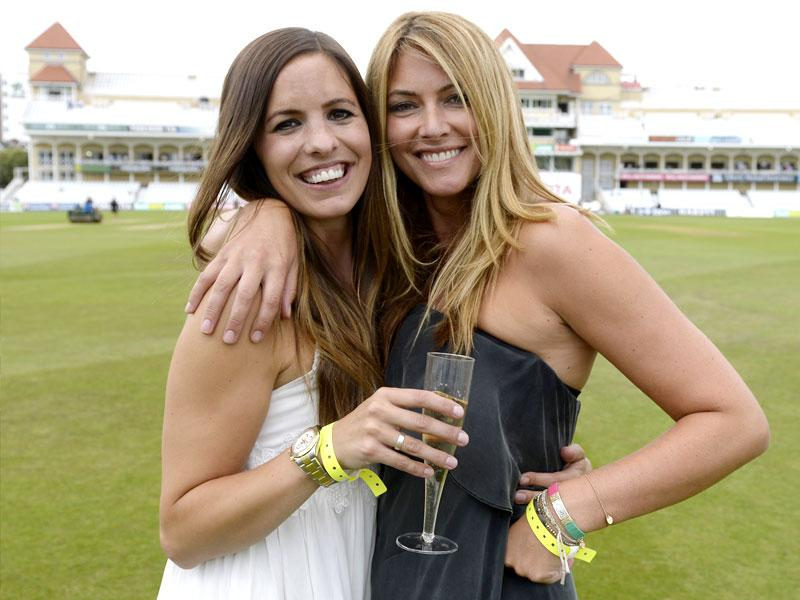 Chantal Bell and Daniella Anderson pose after the fourth Ashes Test match. (Reuters)