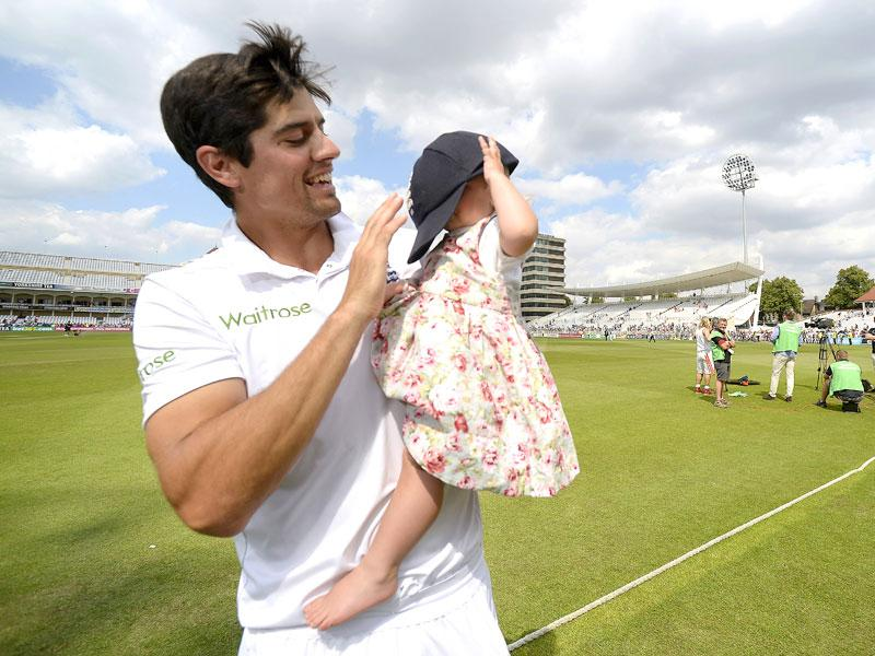 England's Alastair Cook celebrates winning the Ashes with his daughter. (Reuters)