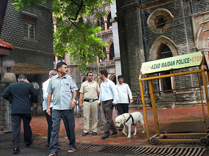 Dog squad of the Mumbai police at work after a high alert was sounded at the Bombay high court. (Photo credit: Bhushan Koyande)