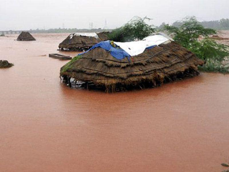 Mud houses of Gujjar's submerged after water levels rose on the banks of the River Tawi during the 2014 floods. HT File Photo