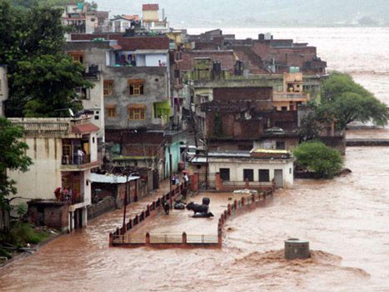 A view of a residential area during heavy rainfall in Jammu during the 2014 floods that wreaked havoc in the Valley. HT File Photo