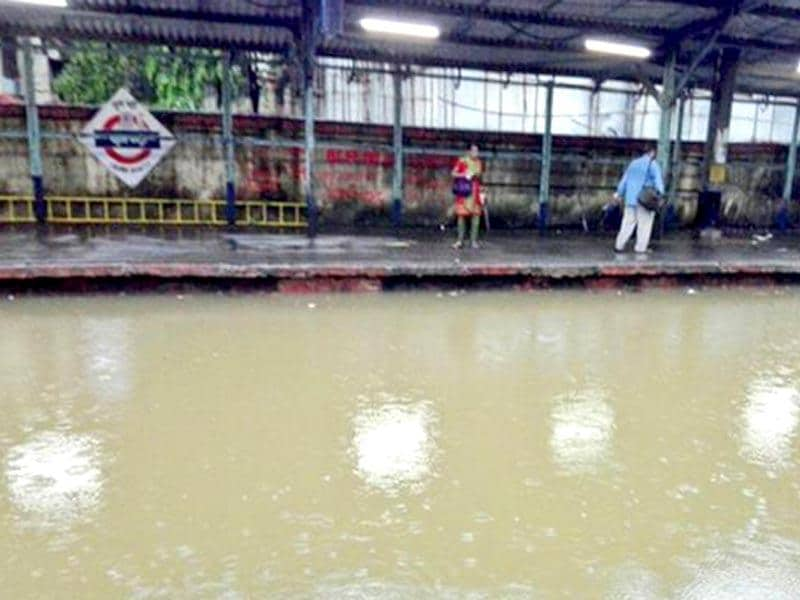 Commuters stranded at the railway station due to the waterlogged railway tracks (Photo by @kkorde01)