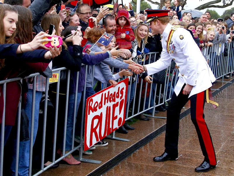 Prince Harry (R) shakes hands with members of the public after visiting the Australian War Memorial in Canberra. (Reuters)
