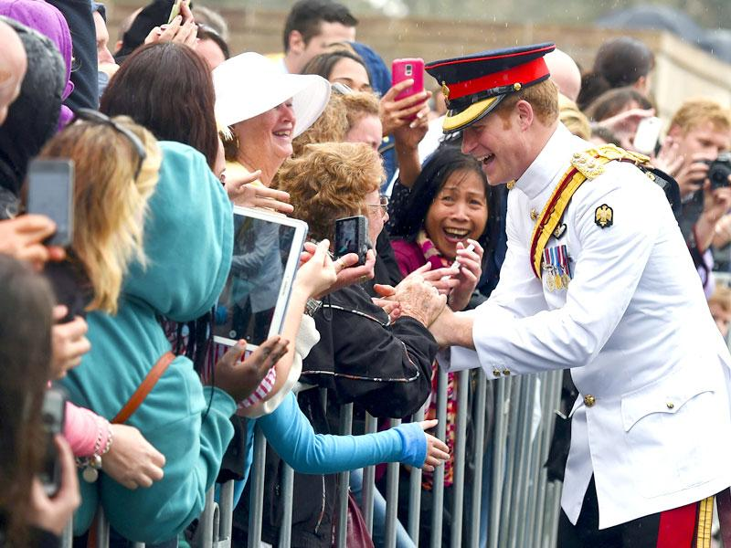 Prince Harry shakes hands with members of the public after visiting the Australian War Memorial in Canberra. (Reuters)