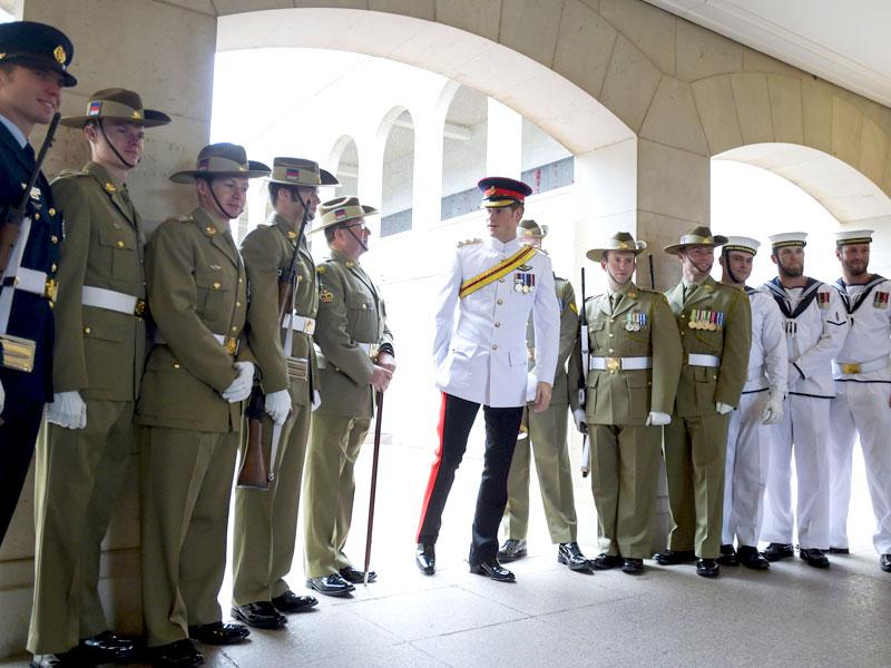 Prince Harry (C) stands with members of the 'Catafalque Party' during a visit to the Australian War Memorial in Canberra April 6, 2015. (REUTERS/Lukas Coch/Pool)