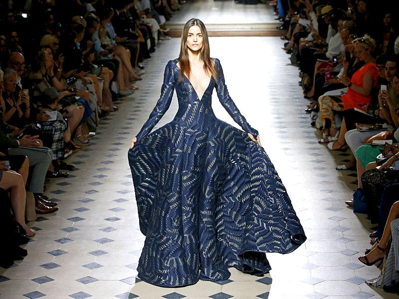 This design by French designer Julien Fournie has a Victorian feel, with the fabric flowing down from a puffed waist. (Reuters/Charles Platiau)