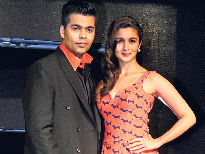 Karan Johar and Alia Bhatt at the launch of a TV channel in Mumbai. (HT photo)