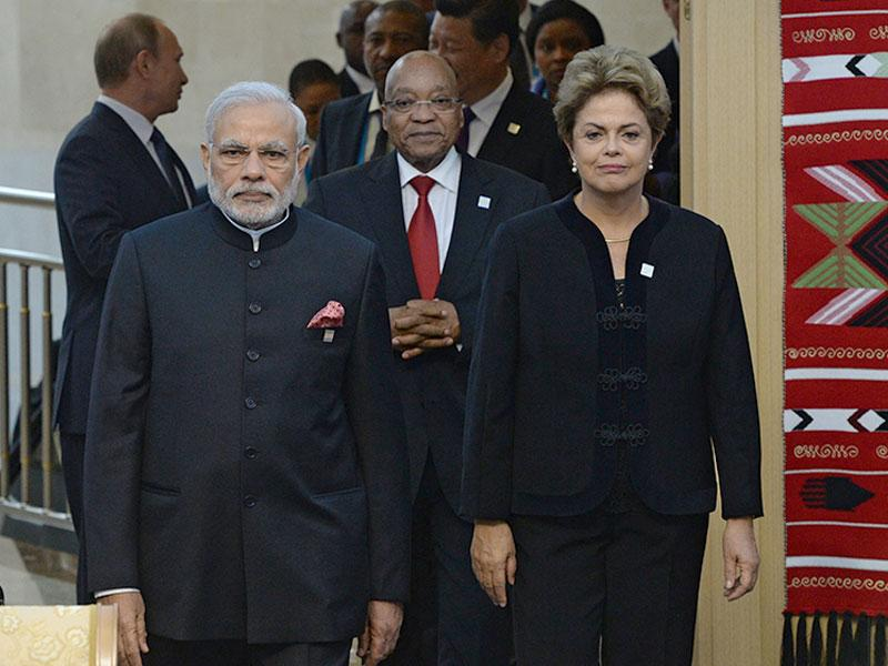 Chinese President Xi Jinping (background centre) listens to Russia's Vladimir Putin (background left) while Brazil's President Dilma Rousseff (right), PM Narendra Modi (left) and South African President Jacob Zuma (centre) take a walk, during BRICS Summit. (Host photo agency/RIA Novosti Pool Photo via AP)