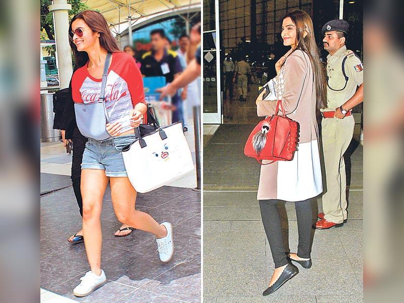 A woman carries her entire world in her handbag - we're sure all the ladies out there will agree. Be it a cross-body sling or the nifty knuckle duster clutches, purses and handbags are essential to every woman's wardrobe. And some of our celebs really know how to carry their quirky handbags that mirror their eclectic style sensibilities. Get pointers from these celebs to find one that suits you best. (Text: Arpita Kala) Actor Alia Bhatt (L) channels her feline style in a tote inspired by designer Karl Lagerfeld's cat, Choupette.Actor Sonam Kapoor (R) goes for a furry bug accessory by Fendi.