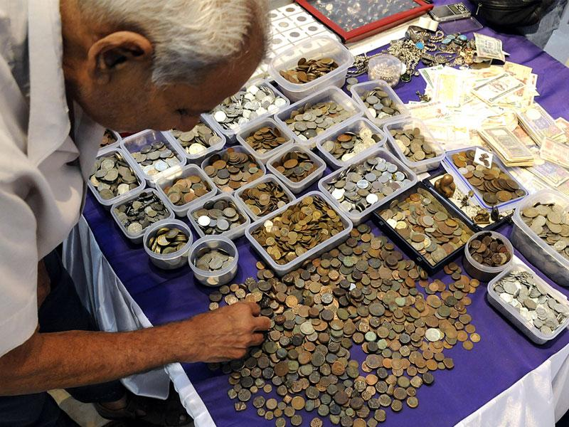 A man having a look at the collection of coins exhibited at the ongoing 3rd Coin Currency and Philately Festival in Indore. (Shankar Mourya/HT)