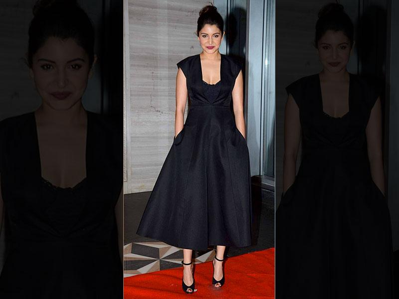 Style busted: Actor Anushka Sharma's look shouts retro in a seductive tone. The bustier over midi dress, dark lips and top bun - what more can you ask for. This minimalistic look is perfect for an evening soirée.