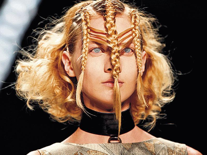 You can step up your braid game with this triple braided, wavy hairstyle by Irene Luft at the Berlin Fashion Week.