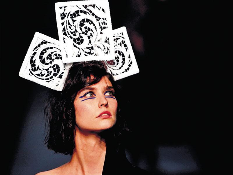 A model flaunts intricately cutout hair accessories at designer Jean Paul Gaultier's show in Paris, France.