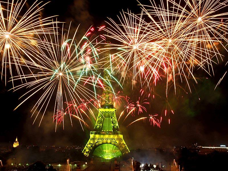 Fireworks illuminate the Eiffel Tower in Paris during Bastille Day celebrations. Bastille Day marks the July 14, 1789, storming of the Bastille prison by angry Paris crowds that helped spark the French Revolution. (AP Photo)