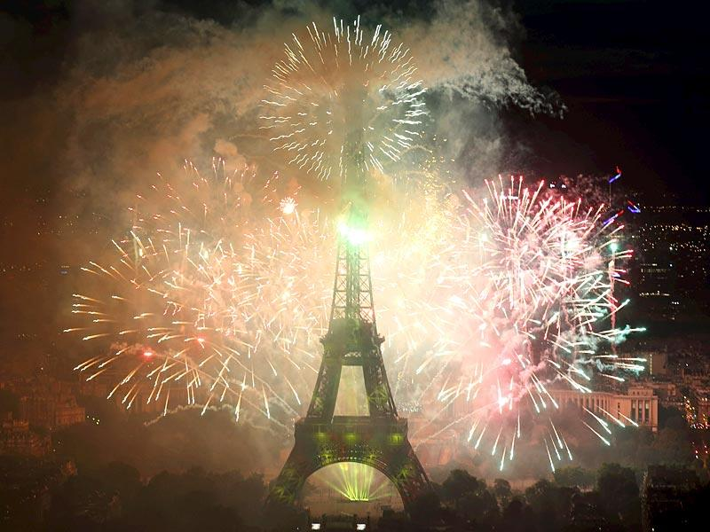 Fireworks light up the sky near the Eiffel Tower to end the traditional Bastille Day celebrations in Paris. (Reuters)