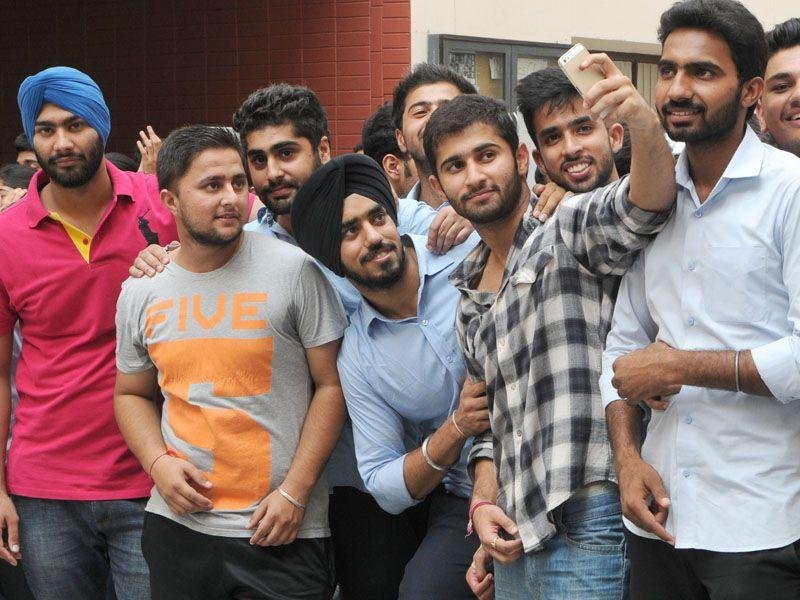 Students taking photographs at first day of college in Chandigarh