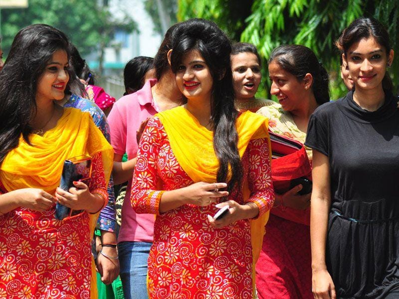 Students coming out of Guru Gobind Singh College for Women (GGSCW) after attending their classes on the first day of new session at sector 26, Chandigarh