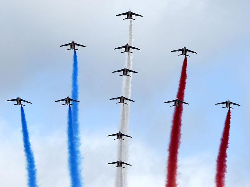 At the annual military parade Alpha Jets of the French Air Force, La Patrouille de France, release trails of blue, white and red smoke in the colours of the French national flag fly over the Champs Elysees. AFP Photo/ Alain Jocard)