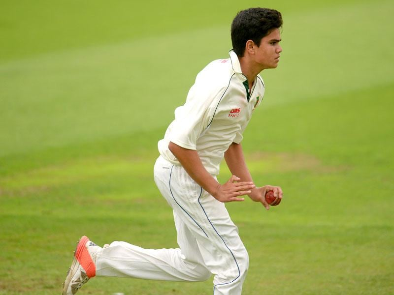 Arjun running in to bowl. (Reuters Photo)