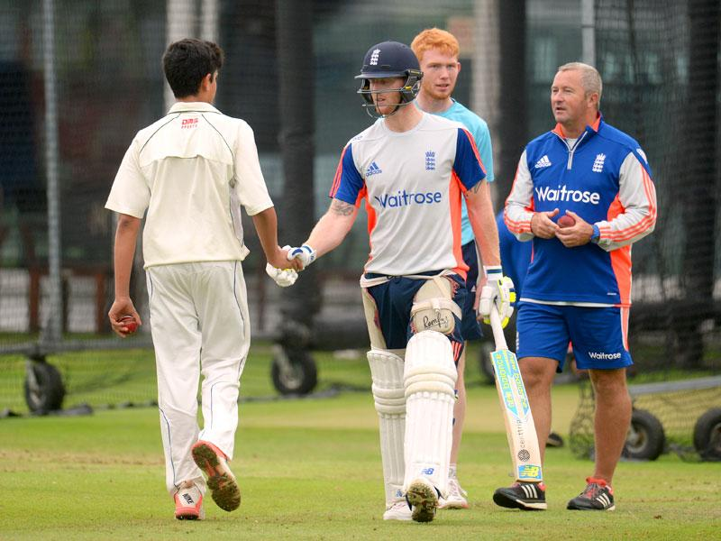 Arjun shakes hands with England's Ben Stokes. (Reuters Photo)