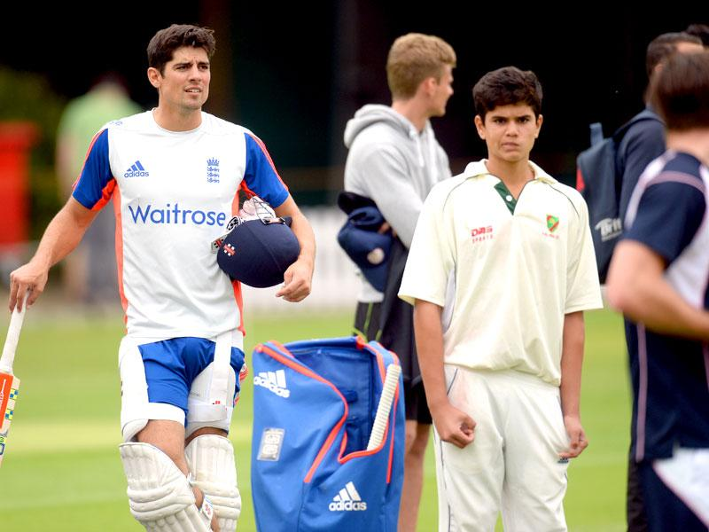 Arjun with England Test captain Alastair Cook. (Reuters Photo)