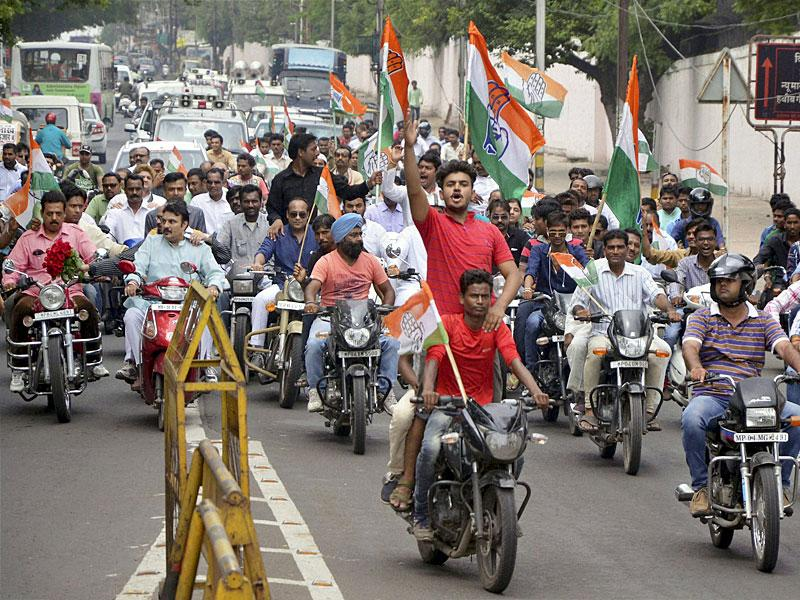 Congress activists taking out rally during their 'Madhya Pradesh Bandh' call against Vyapam ccam, in Bhopal. (PTI Photo)