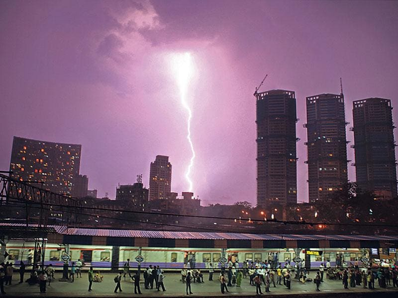 A flash of lightning illuminates the sky over Mahalaxmi railway station on October 14, 2011. The photo won the top honour at the National Press Photo Contest of the Media Foundation of India, in the 'Daily Life' category. (Vijayanand Gupta/HT photo)