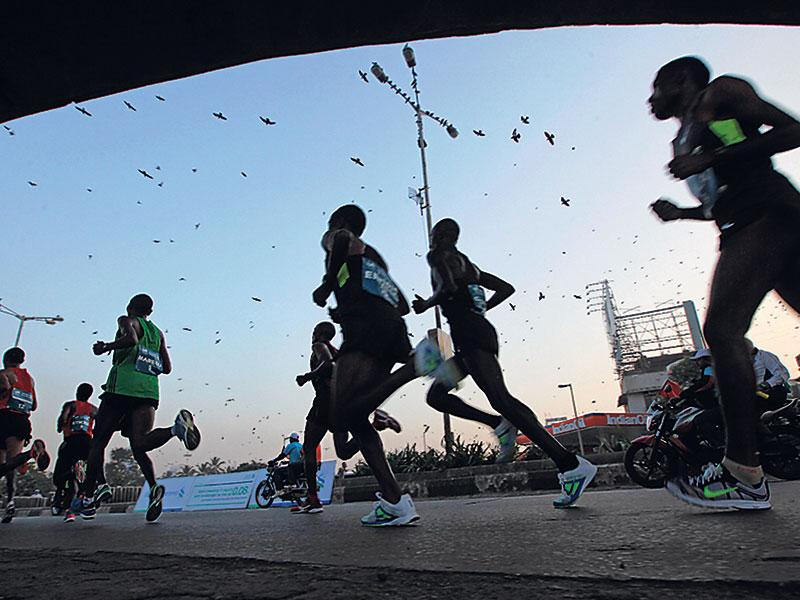 Some of the world's top marathoners run through the streets of Mumbai during the 2013 edition of the Mumbai marathon, heldon January 20. The photo won the Standard Chartered Mumbai Marathon First Runner-Up Award. (Vijayanand Gupta/HT photo)
