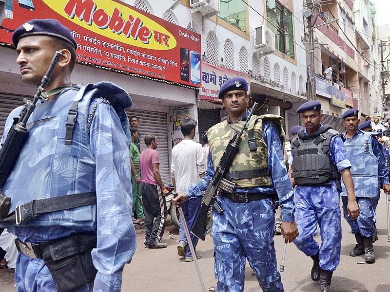 RAF personnel patrol a street during a bandh called by the Congress party over Vyapam scam in Bhopal. (PTI Photo)