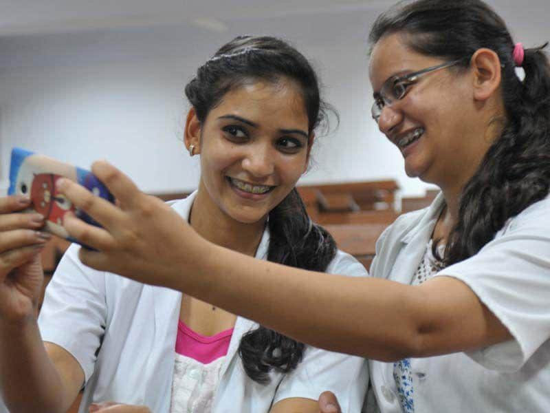 Girls taking part in the IOS Selfie Smile competition at Dental institute of Punjab university Chandigarh on Thursday July 16, 2015 (Ravi Kumar/HT)