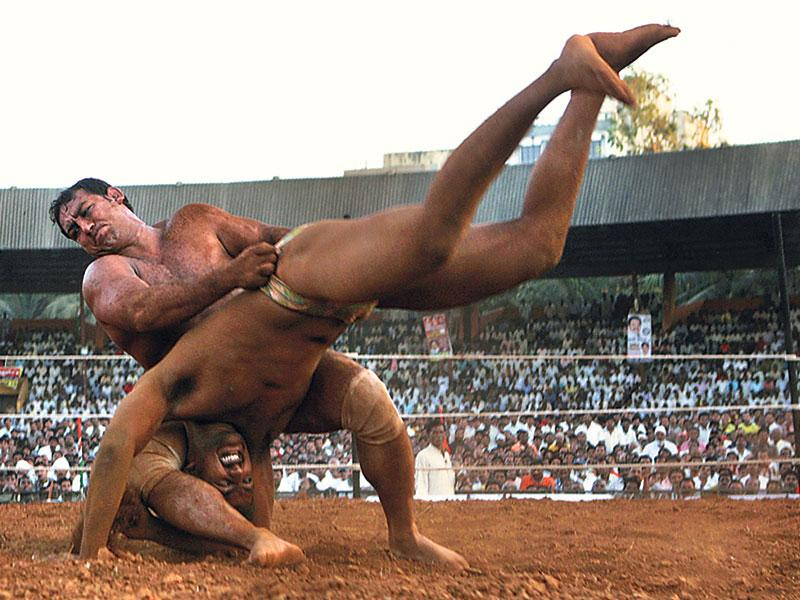 Wrestler Ahsab Ahmed (left), who eventually won the match, tries to overturn Nivrutti Bidge at the Andheri Sports Complex on February 1, 2009. This photo won the Silver Prize in the 'Sports Photography' category at the IFRA Awards. (Satish Bate/HT photo)
