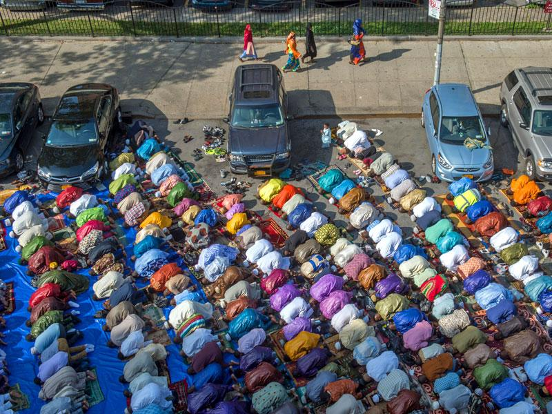 Worshipers in New York's East Harlem neighborhood take part in the traditional annual prayer commemorating the end of Ramzan in front of the Masjid Aqsa-Salam mosque (AP Photo)