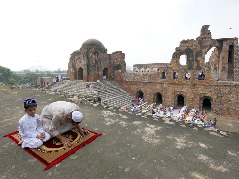 Prayers being offered during Eid al-Fitr at Feroz Shah Kotla fort mosque in New Delhi on Saturday. Eid al-Fitr marks the end of the fasting month of Ramadan. (Arun Sharma/ HT Photo)