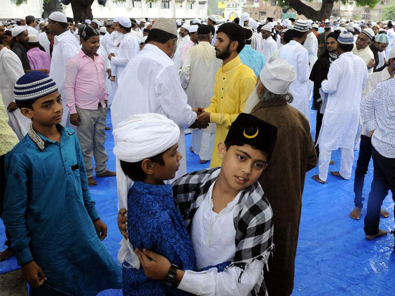 Rain failed to dampen Eid festivities in Bhopal and Indore. People greet each other after offering Eid prayers at Sadar Bazaar Eidgah in Indore. (Arun Mondhe/ HT)