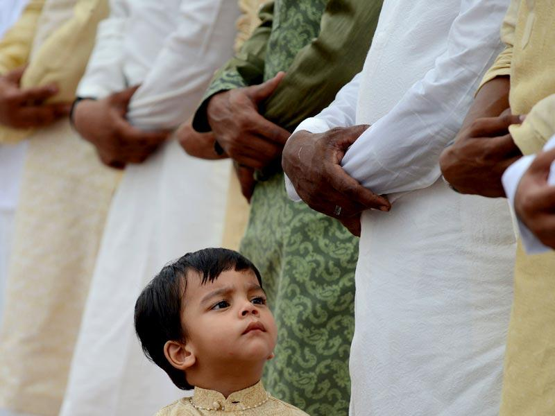 Devouts gather outside to offer prayers during Eid al-Fitr at Jama Masjid mosque in New Delhi. (AFP Photo)