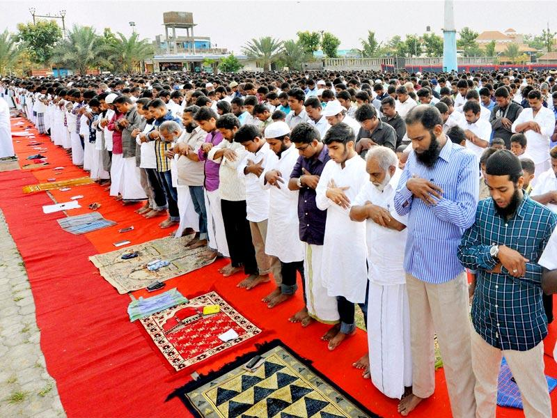 Muslim of Jaqh's group offer namaz on the occasion of Ramzan festival in Coimbatore. (PTI Photo)