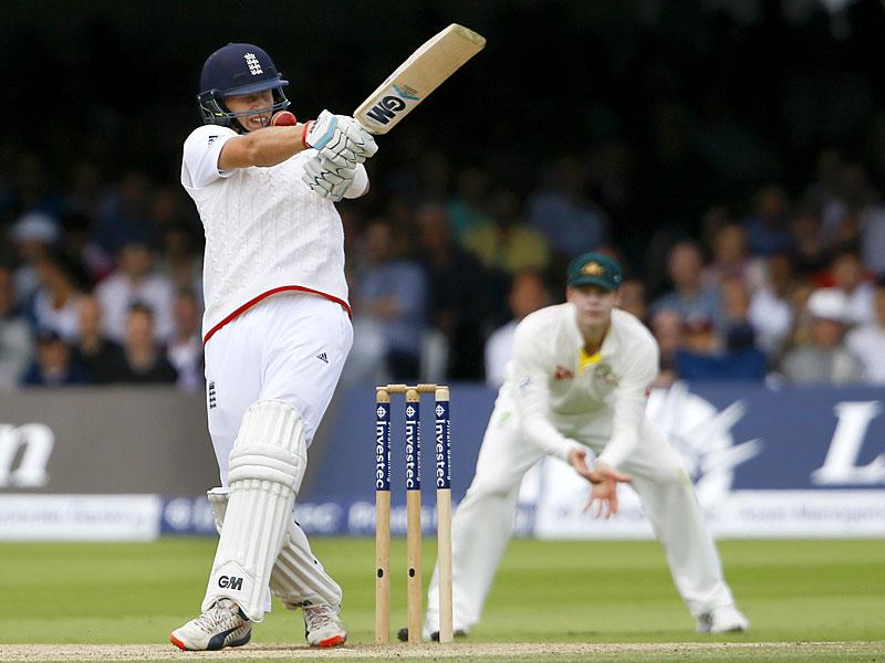 England's Joe Root gets a ball on the grill of his helmet as he plays a shot off the bowling of Australia's Mitchell Johnson on the fourth day of the second Ashes Test match between England and Australia, at Lord's cricket ground in London. (AP Photo)