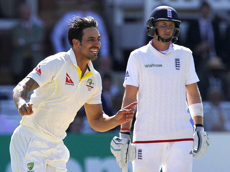 Australia's Mitchell Johnson (L) celebrates taking the wicket of England's Moeen Ali on the fourth day of the second Ashes cricket test match between England and Australia at Lord's cricket ground in London. (AFP Photo)