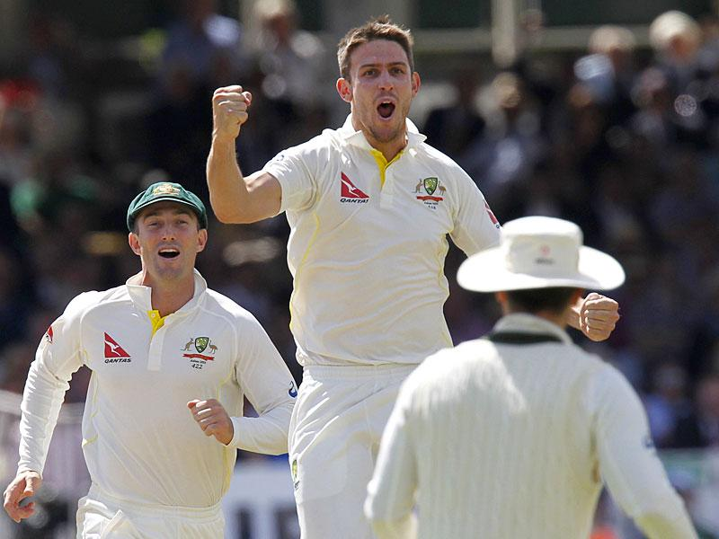 Australia's Mitchell Marsh (C) celebrates taking the wicket of England's Gary Ballance on the fourth day of the second Ashes cricket test match between England and Australia at Lord's cricket ground in London. (AFP Photo)