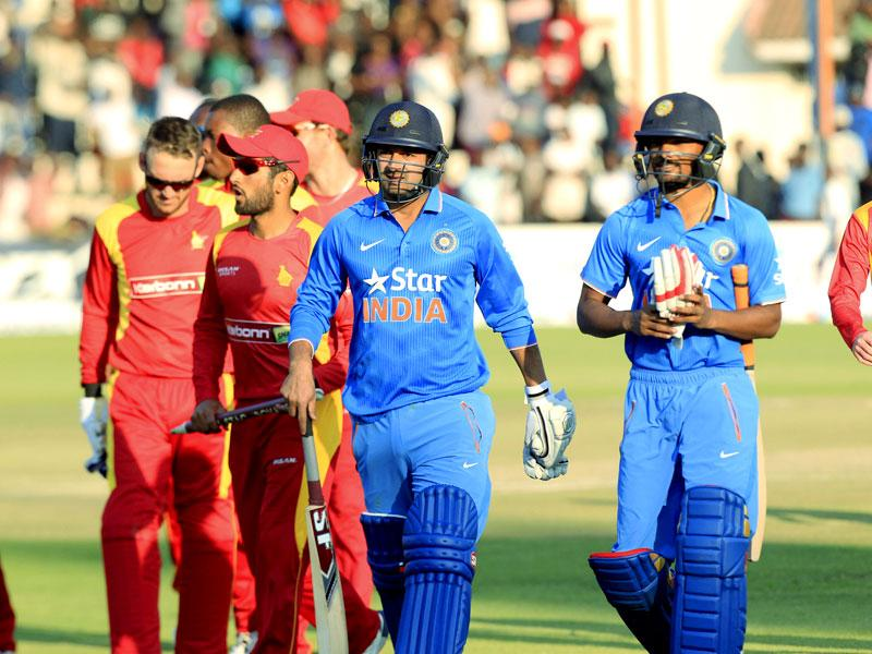 Indian batsmen walk off the pitch after the loss. (AP Photo)