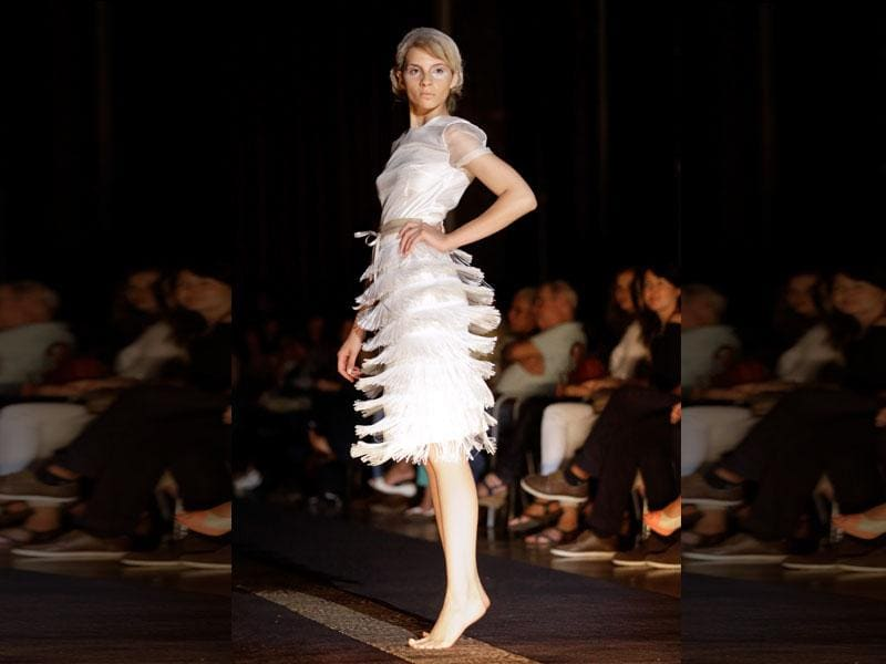 A model wears a dress by Namibia's designer Nikola Corandie during her show at the MODAAFRICA, African fashion week. (AP Photo/Armando Franca)