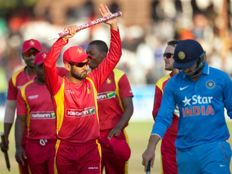 Stand-in Zimbabwe captain Sikandar Raza, left, acknowledges the crowd after securing victory over India. (AFP Photo)