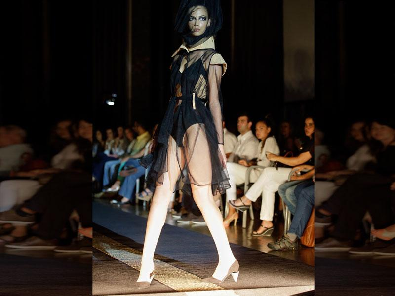 A model wears an outfit by South African designer Suzaan Heyns during her show at the MODAAFRICA, African fashion week. (AP Photo/Armando Franca)