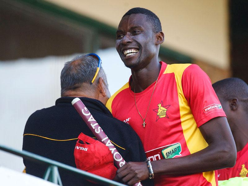 Zimbabwe bowler Christopher Mpofu, right, embraces coach Dave Whatmore after the win. (AFP Photo)