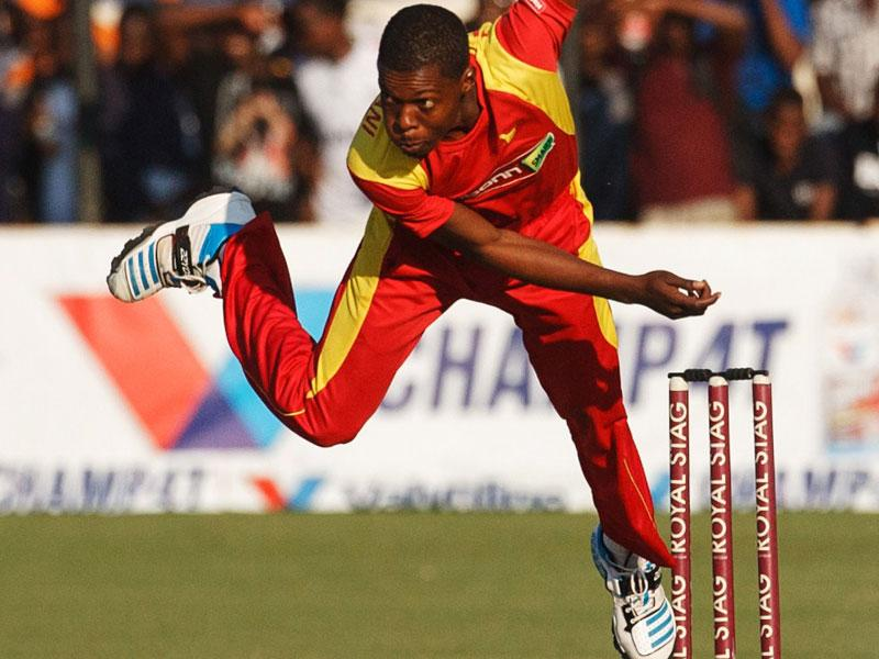 Zimbabwe bowler Taurai Muzarabani bowls during the match. (AFP Photo)