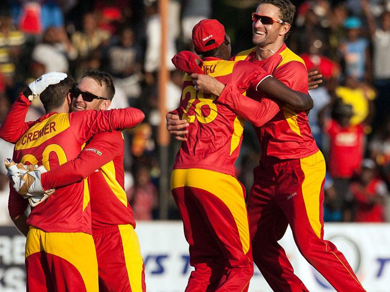 Zimbabwe player Craig Ervine, right, jumps to embrace Christopher Mpofu, second from right, as they celebrate defeating India. (AFP Photo)