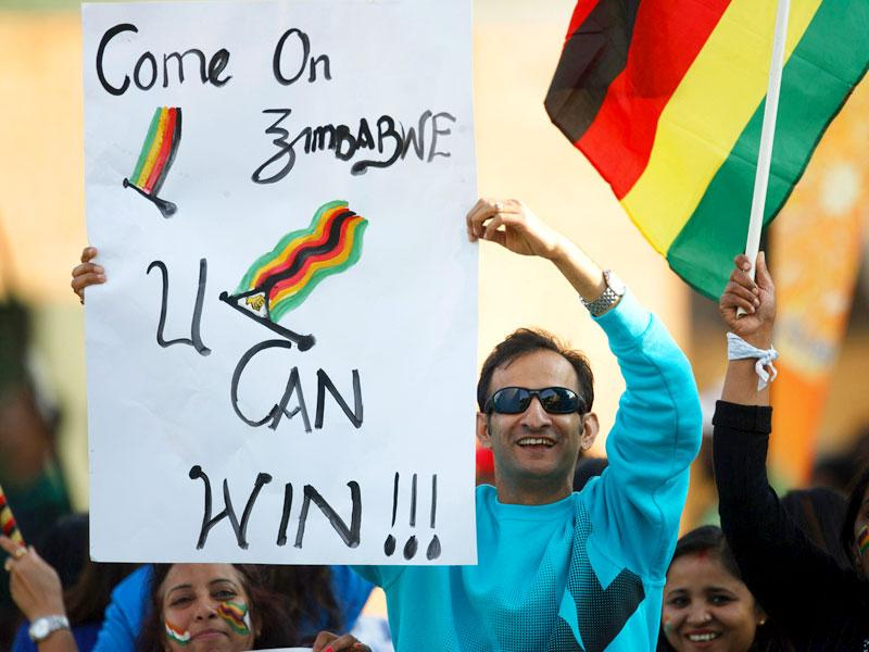 Zimbabwe supporters hold up banners during the team's second T20 encounter against India. (AFP Photo)