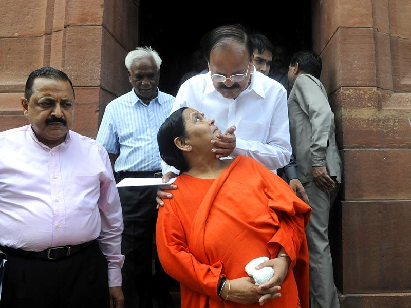 BJP leaders Venkaiah Naidu and Uma Bharti coming out after attending the monsoon session (Sushil Kumar/HT Photo)