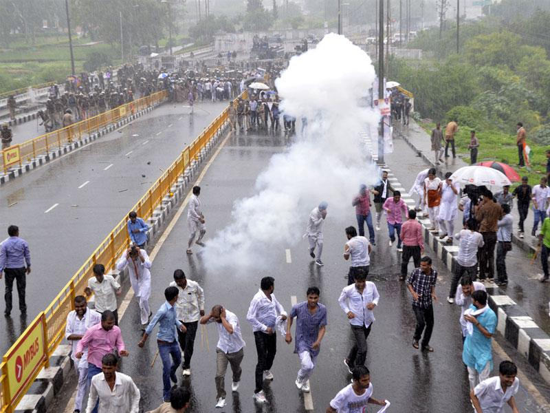 Police lobbed teargas shells to disperse Youth Congress activists during a protest at the CM's residence, in Bhopal on Thursday. (Mujeeb Faruqui/HT)