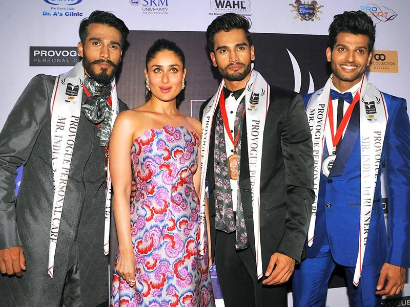 Kareena Kapoor Khan was spotted at Provogue Mr India event with second runner up Pratik Gujral (L) winner Rohit Khandawal (2R) and first runner up Rahul Rajasekharan (R) in Mumbai. (AFP Photo)